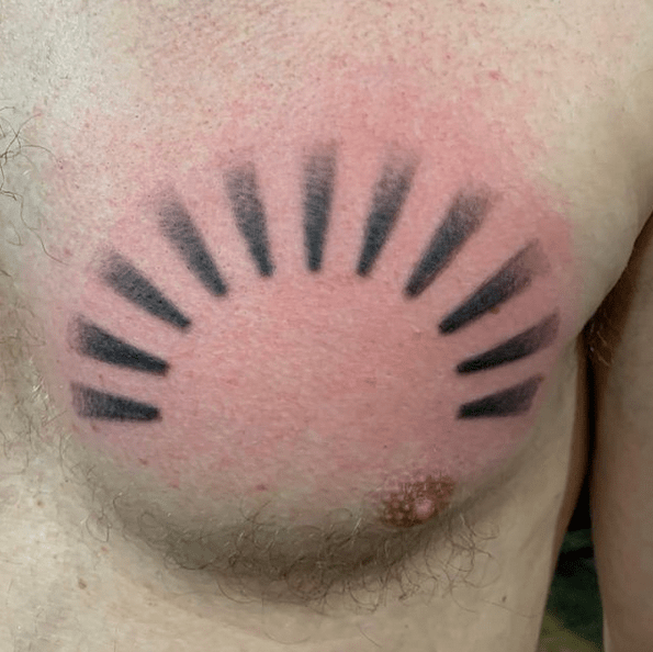 Simple sun rays tattoo on chest by @renaissance_tattoo