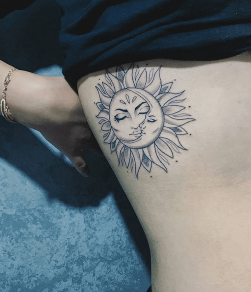 Small sun and moon tattoo by @kyoto_tattoo_o8