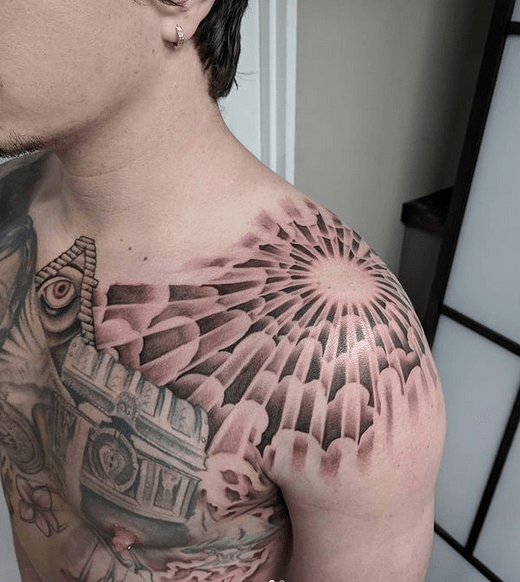 Sun rays shoulder tattoo by @nicholasoryan666