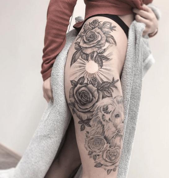 Sun rays tattoo through roses on the hip by @lindartetattoo