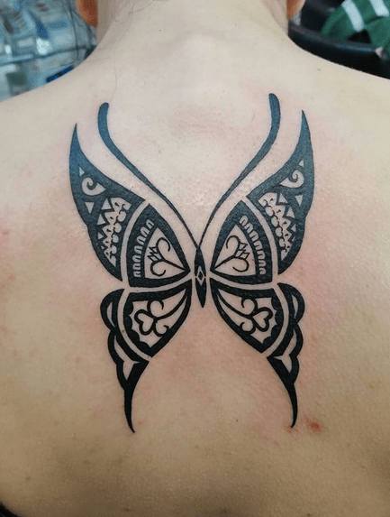 Tribal butterfly tattoo by @dino_horus
