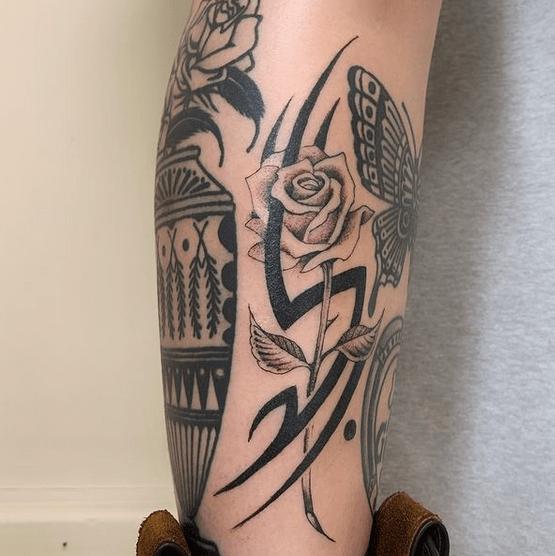 Tribal rose tattoo by @jordanbaxtertattoo