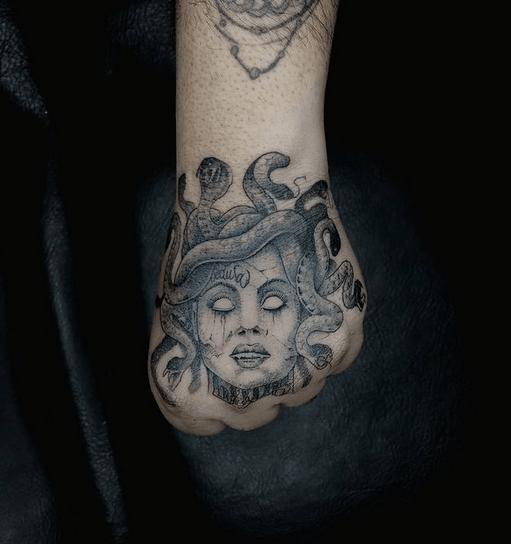 Dark medusa hand tattoo by @edibetter