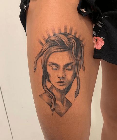 Elegant medusa thigh tattoo by @ashbyink