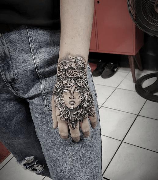 Full hand medusa tattoo by @lucian_roza_tattoos