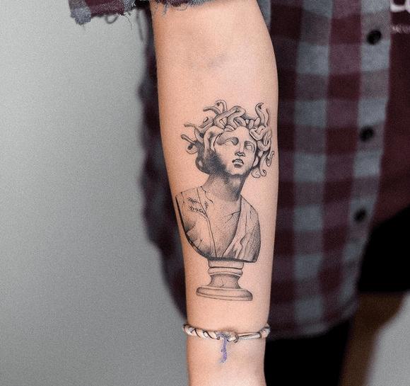 Greek sculpture medusa tattoo by @tattooist_eliya