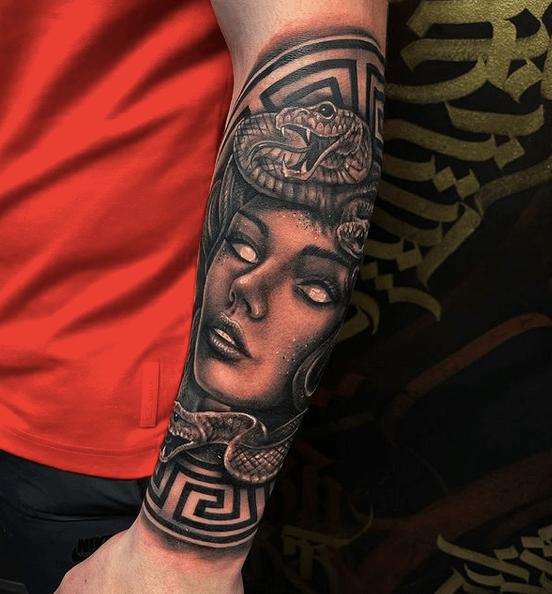Half sleeve Versace Medusa tattoo by @blackonyxtattooco