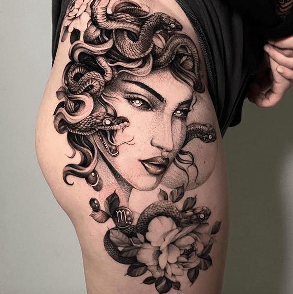 Medusa and flowers thigh tattoo by @dxm_tattooart