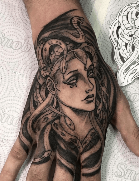 Medusa hand tatoo by @matheusbrandaotattoo