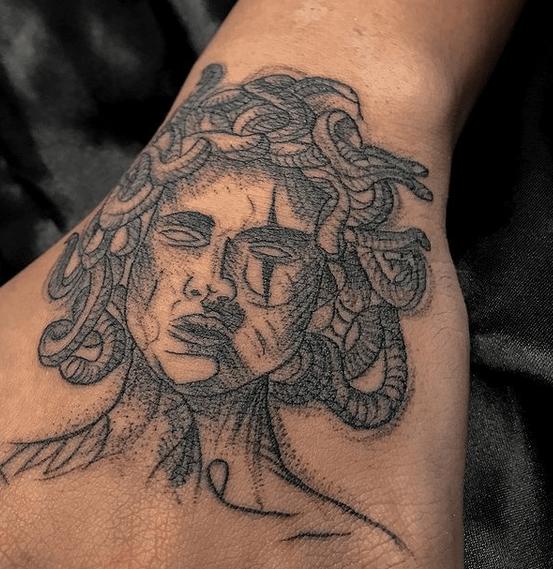Medusa hand tattoo by @geoartattoo