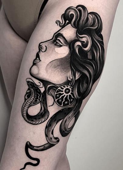 Medusa thigh tattoo by @lupu.tattoo