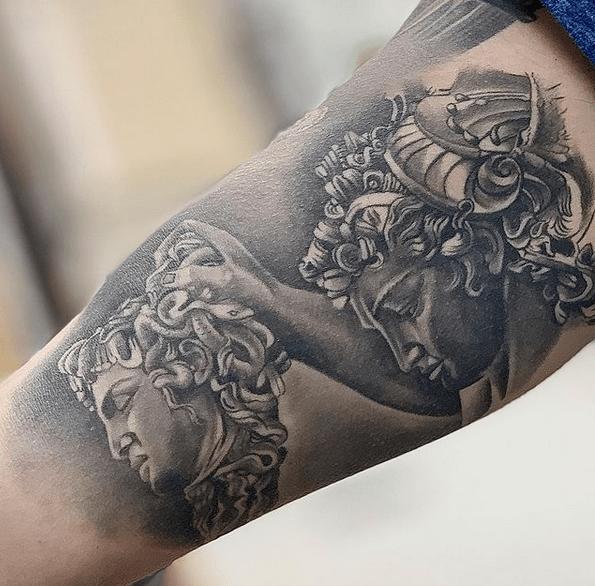 Perseus holding Medusas hand tattoo by @johnmenatattoo