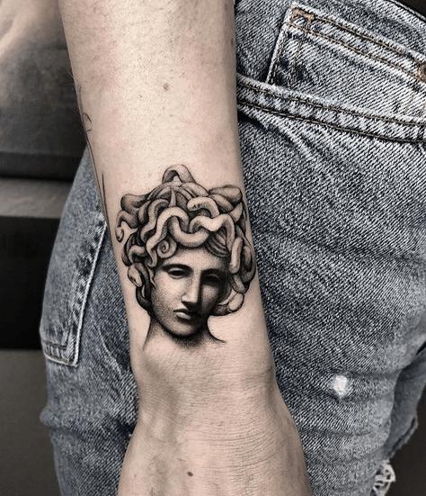 Realistic medusa sculpture tattoo by @martin_b_ttt