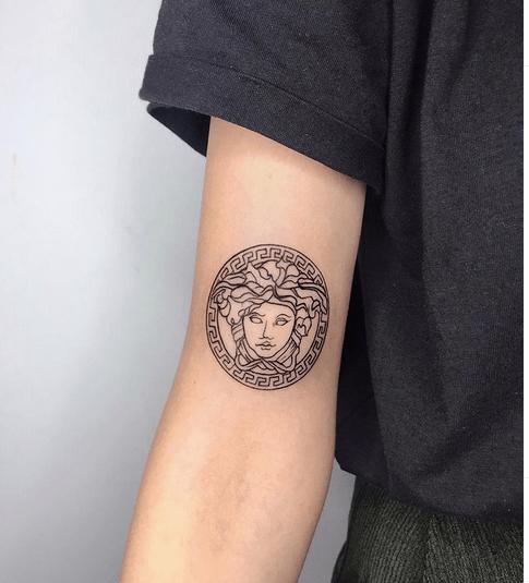 Simple Versace medusa tattoo by @ko_ink