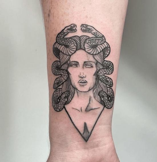 Simple medusa tattoo by @deka_tattoo