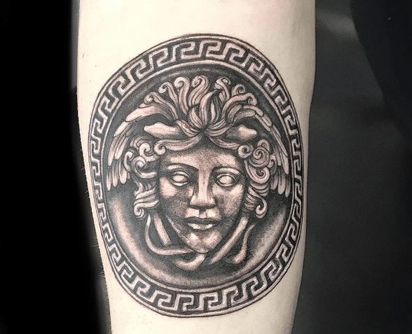 Small Versace Medusa tattoo by @lisbeth_tattooartist