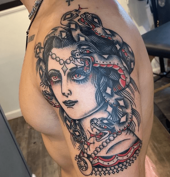 Traditional medusa tattoo on the shoulder by @scottattoos